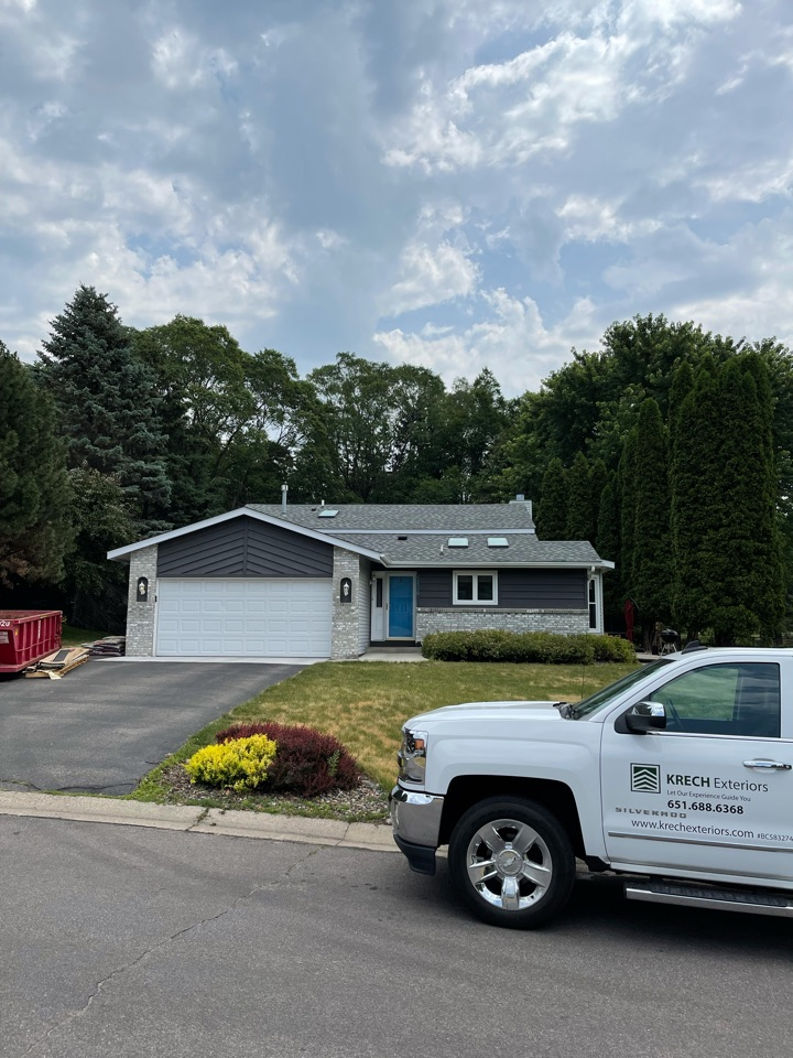 Apple Valley, MN - Installed new Soffit and Fascia on all elevations. Installed white woodgrain steel facia and white aluminum soffit all throughout. Another great looking job done by a Krech Exteriors