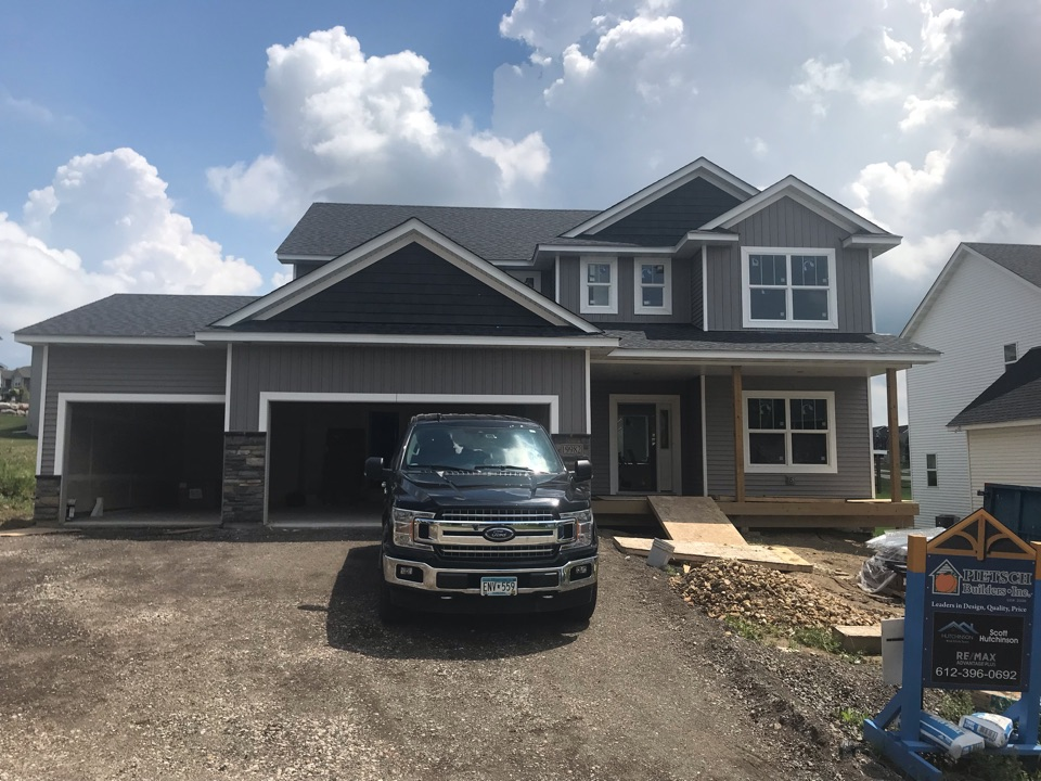 Lakeville, MN - New home with vinyl lap siding, vinyl shakes, vinyl board and baton. Aluminum soffit and fascia