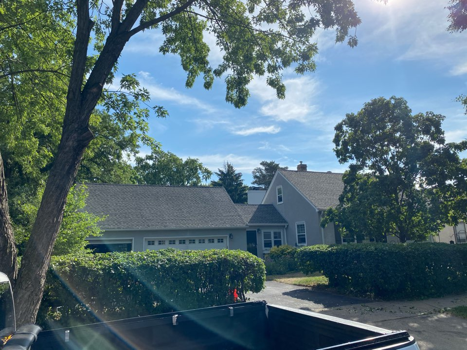 Minneapolis, MN - Installed GAF Timberline HDZ Architectural Asphalt Shingle in the color Weathered Wood. All roofing material including underlayment material such as Tar Paper and Ice & Water was installed per GAF regulations/specifications. All metal flashing material such as Roof Vents, W Valleys, Pipe Stacks, Dormers, and Step Tins were installed in the color Bronze to coincide with the color of the shingle. Great looking new roof!