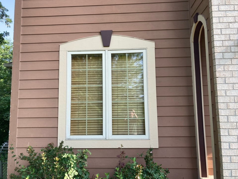 Inver Grove Heights, MN - Free inspections free estimate replace damage James Hardie siding replaced round top trim on window