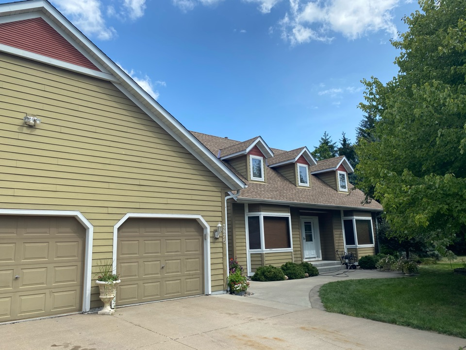 Inver Grove Heights, MN - Installed GAF Timberline HDZ Architectural Asphalt Shingle in the color Shake Wood. All roofing material including underlayment material such as Tar Paper and Ice & Water was installed per GAF regulations/specifications. All metal flashing material such as Roof Vents, W Valleys, Pipe Stacks, Dormers, and Step Tins were installed in the color Bronze to coincide with the color of the shingle. Great looking new roof!