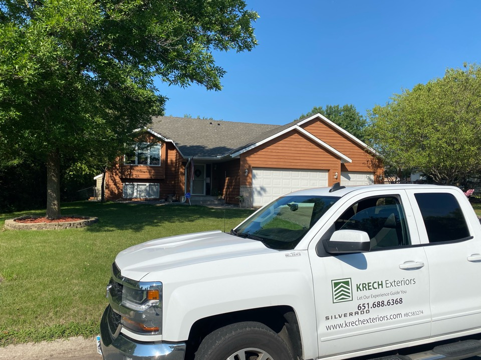 Farmington, MN - Installed GAF Timberline HDZ Architectural Asphalt Shingle in the color Weathered Wood. All roofing material including underlayment material such as Tar Paper and Ice & Water was installed per GAF regulations/specifications. All metal flashing material such as Roof Vents, W Valleys, Pipe Stacks, Dormers, and Step Tins were installed in the color Bronze to coincide with the color of the shingle. Great looking new roof!