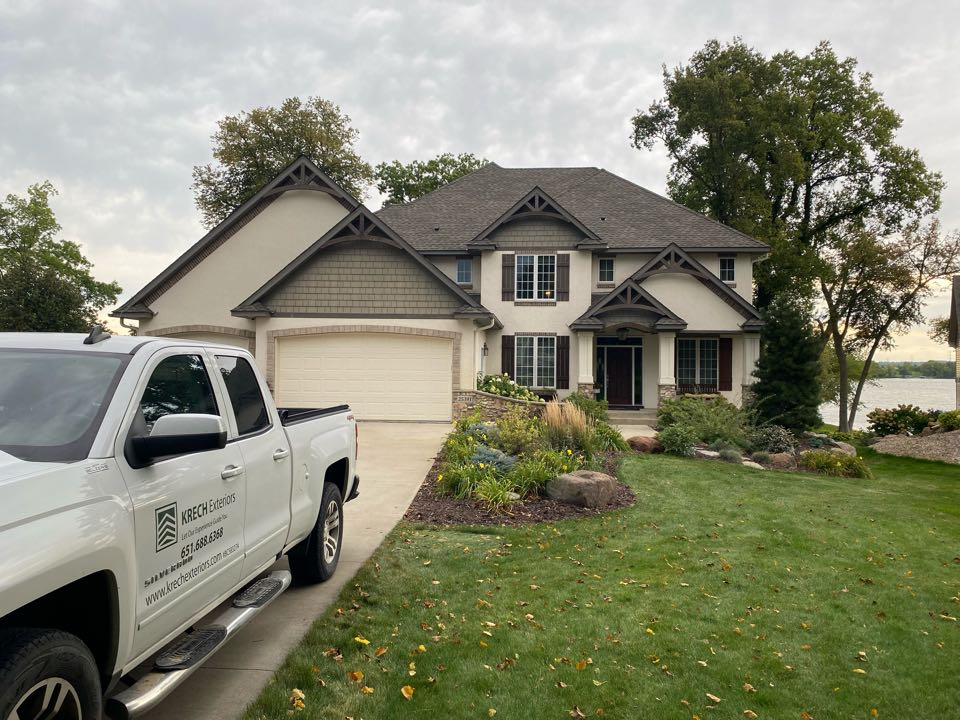 New Prague, MN - Installed GAF Timberline HDZ Architectural Asphalt Shingle in the color Weatherwood. All roofing material including underlayment material such as Tar Paper and Ice & Water was installed per GAF regulations/specifications. All metal flashing material such as Roof Vents, W Valleys, Pipe Stacks, Dormers, and Step Tins were installed in the color Bronze to coincide with the color of the shingle. Great looking new roof!