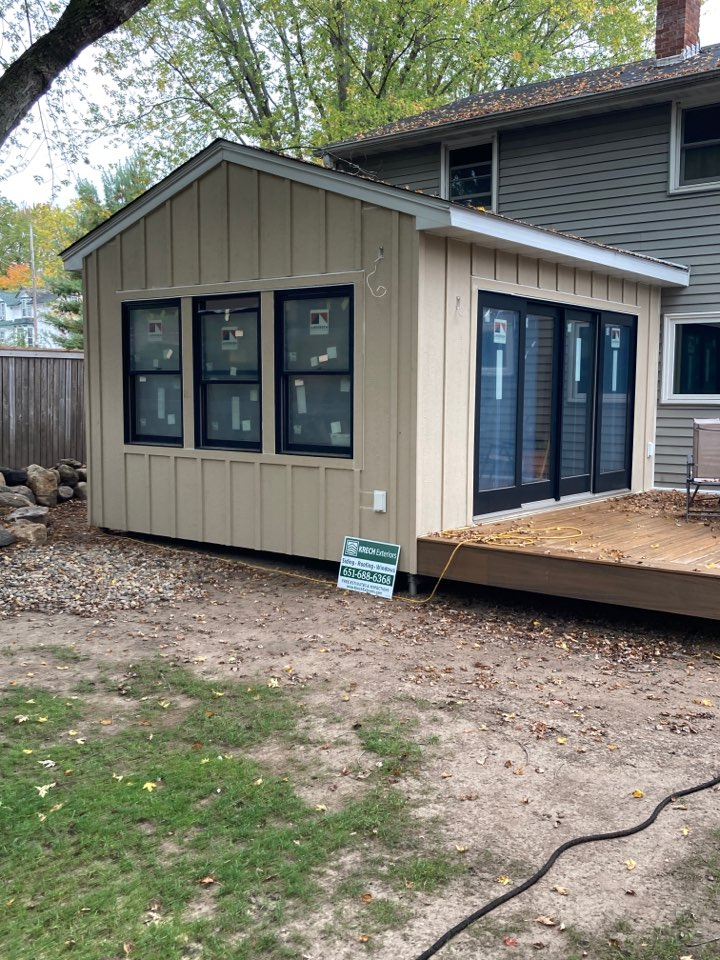 """Stillwater, MN - Home Addition: Board and batten on 3 elevations in """"Primer"""" color. Timberline HDZ shingles in """"Charcoal"""" color. Aluminum fascia and soffits """"White"""" in color. House to be painted to Homeowners choice."""