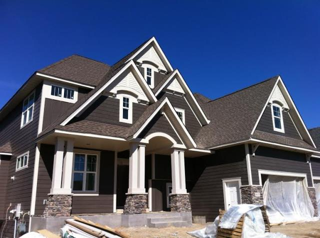 New Brighton, MN - Finishing up an James Hardie Siding installation in New Brighten.