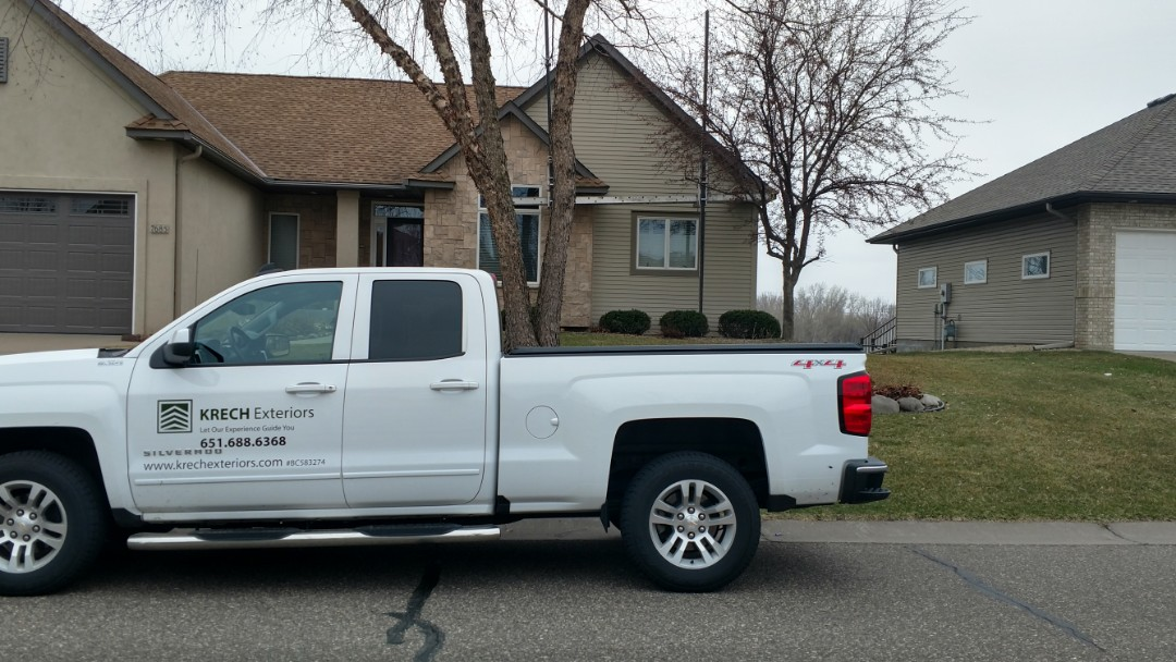 Oakdale, MN - New LP lap siding... Removed stucco, pulled window and installed new pan flashing. Installed new LP trim and siding.