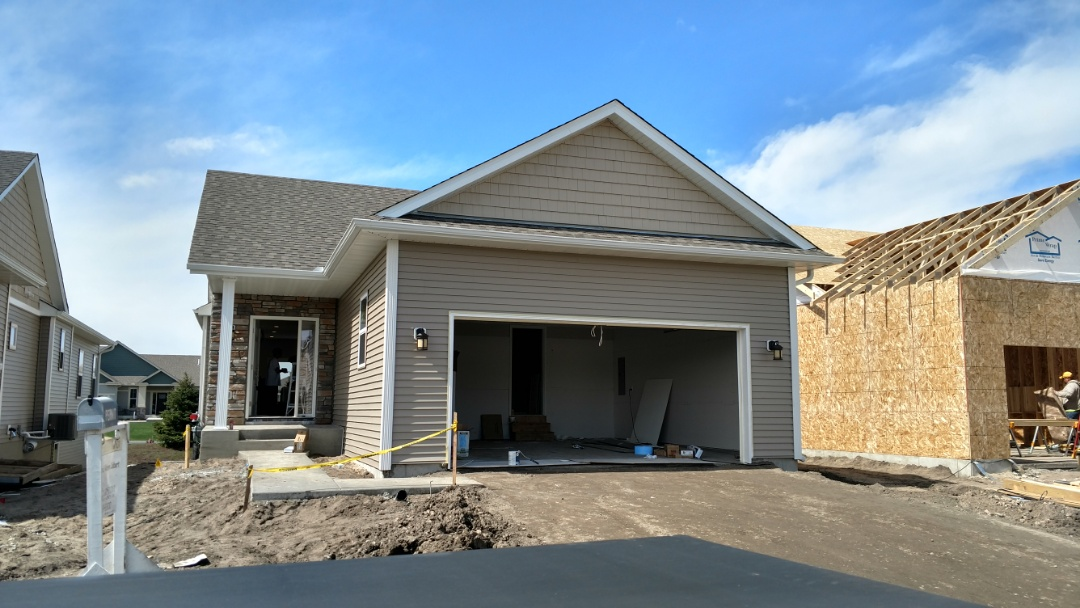 "Farmington, MN - New Vinyl siding job. Installed new D/4 Vinyl siding, color ""Stone Mountain Clay"" Installed new gutters. Installed Vinyl? shakes on garage gable. Installed aluminum soffit and fascia."