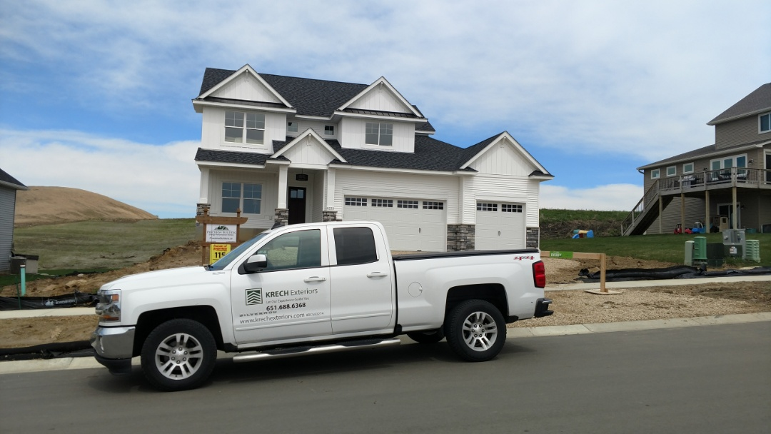 "Lakeville, MN - New Vinyl siding job. Installed new D-4 vinyl siding with B&B on the front. Color""white"". Installed new white aluminum soffit and fascia."