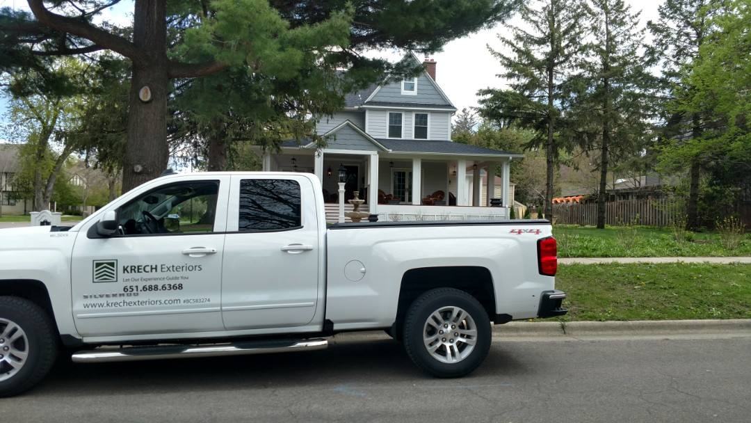 Northfield, MN - New LP siding job. Installed primed LP lap siding with primed shakes in the gables. Installed new gutters. Installed new beaded soffits on front wrap around porch.