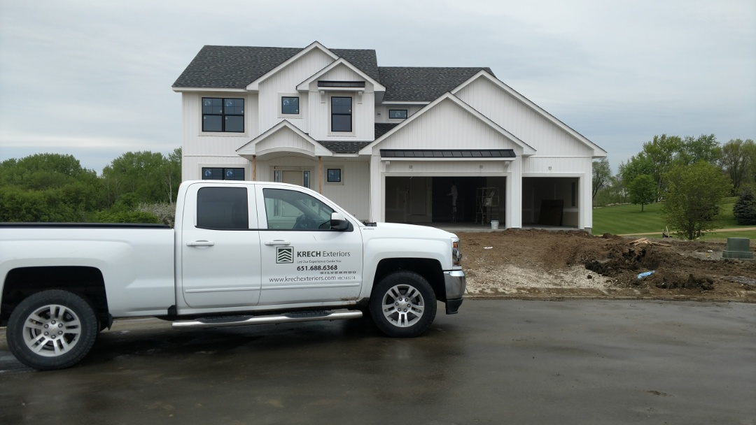 "Lakeville, MN - Another new construction exterior project done by Krech Exteriors. Installed Dutch Lap vinyl siding, ""White"" with vinyl B&B, ""White"" on front of the house. Installed white aluminum soffit and fascia."