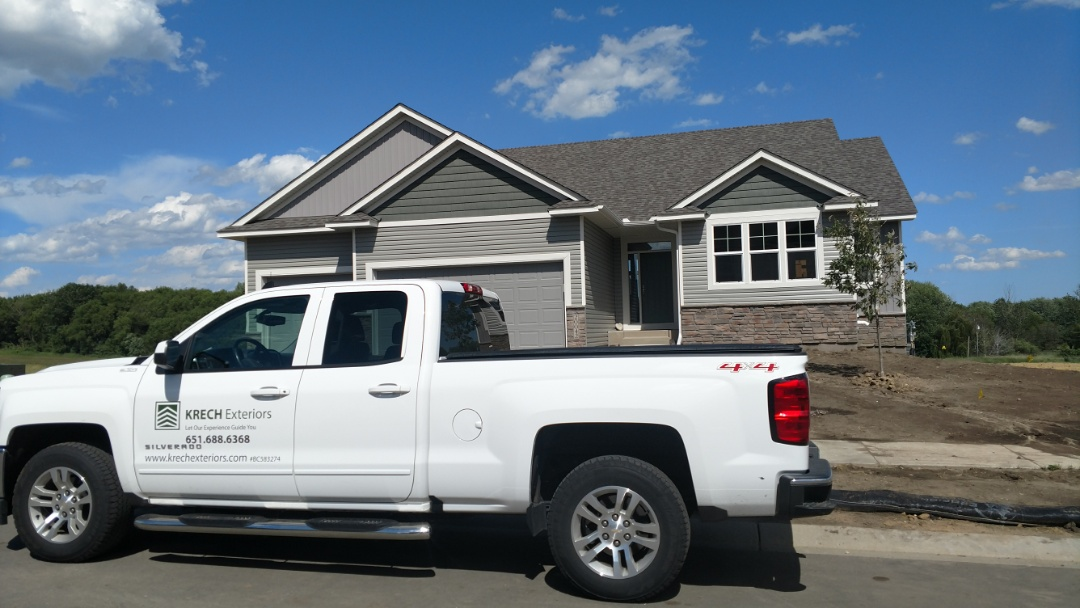 Lakeville, MN - Another nice new construction job done by Krech Exteriors. Installed vinyl lap siding with B&B and vinyl shakes on front gables. Installed aluminum soffit and fascia.
