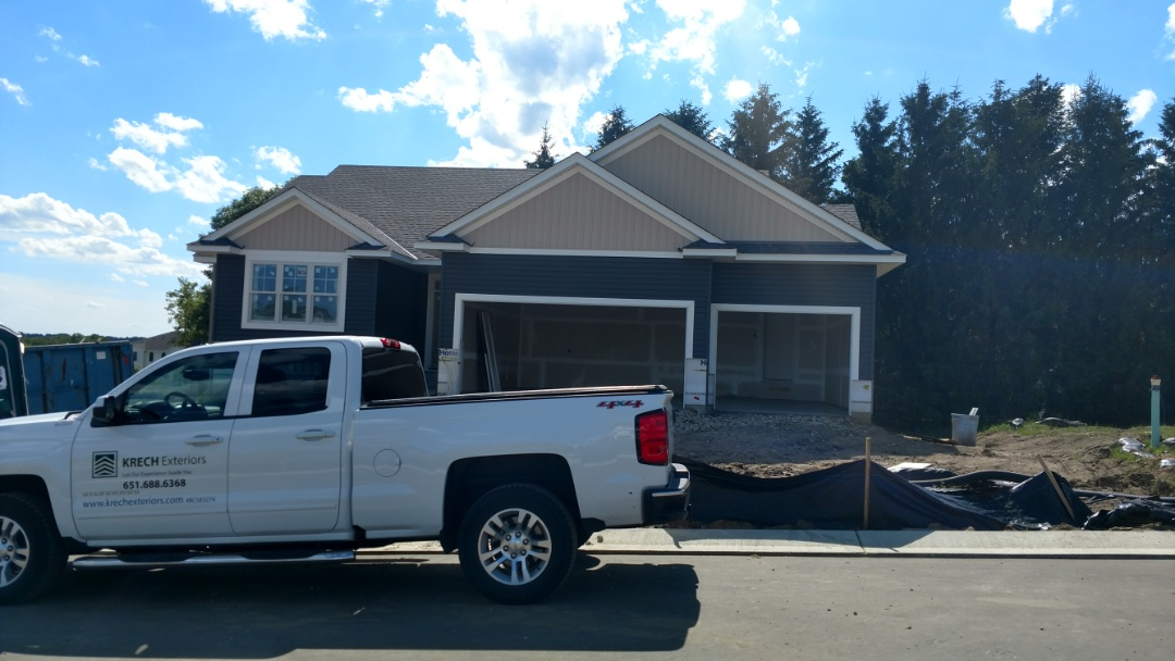 Lakeville, MN - Another nice new construction job done by Krech Exteriors. Installed vinyl lap siding with B&B on the front gables. Installed aluminum soffit and fascia.
