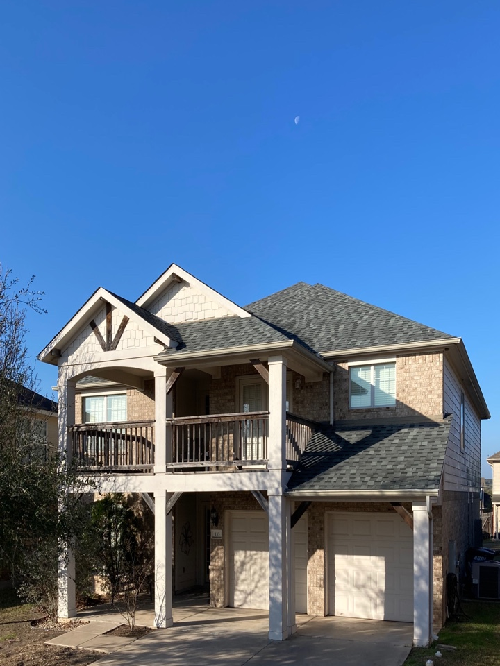 Leander, TX - This home had some significant wind damage.  The homeowner decided to upgrade to a laminate shingle and went with Atlas Architectural Shingles, color Hearthstone Gray.