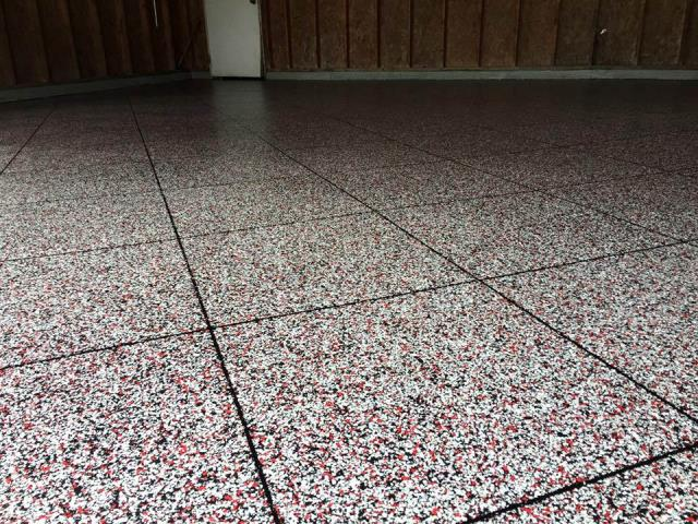 Defiance, OH - Epoxy Flake flooring is a strong industrial coating designed to be an alternative to Terrazzo. It is perfect for epoxy garage flooring, kitchens, showrooms, and man caves!