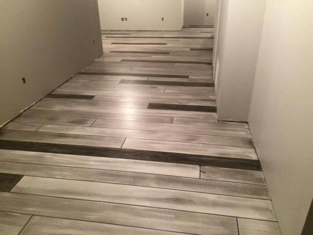 Fort Wayne, IN - For interior or exterior applications, with our Concrete Wood epoxy floors, you'll never have to stain again, never have to worry about water damage and have a rustic wood floor like none other!
