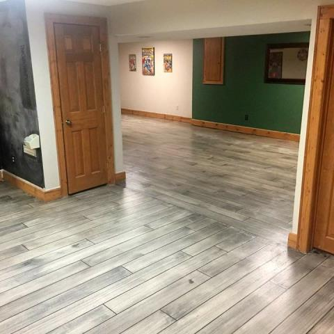 Auburn, IN - Not just your average concrete paint, we offer beautiful hand-designed custom floors for any space in your home! Epoxied floors are great for all living spaces!