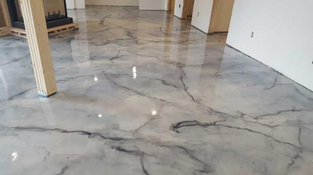 Warsaw, IN - Not just your average concrete paint, we offer beautiful hand-designed custom floors for any space in your home or business! Epoxied floors are great for all spaces!