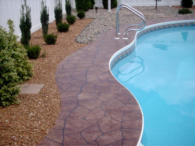 Roanoke, IN - The authentic look of large stone or traditional stamped concrete without breaking the bank! Create over-sized stones on pool decks, patios, porches, and more. Not your average epoxied floor!