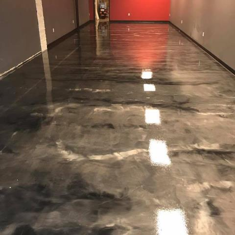 Warsaw, IN - Not just your average concrete paint, we offer beautiful hand-designed custom floors for any space in your home! Epoxied floors are great for all living spaces!