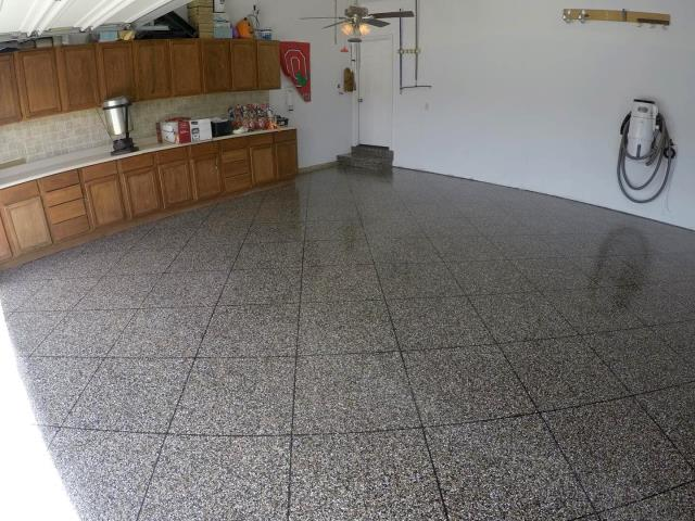 Roanoke, IN - The Epoxy Flake Flooring system makes concrete flooring as beautiful as it is practical and cost-effective. This system is highly recommended for epoxy garage floors, hallways, recreational rooms, warehouses, factory areas, industrial areas, locker rooms, stair cases, fire stations, and much more!