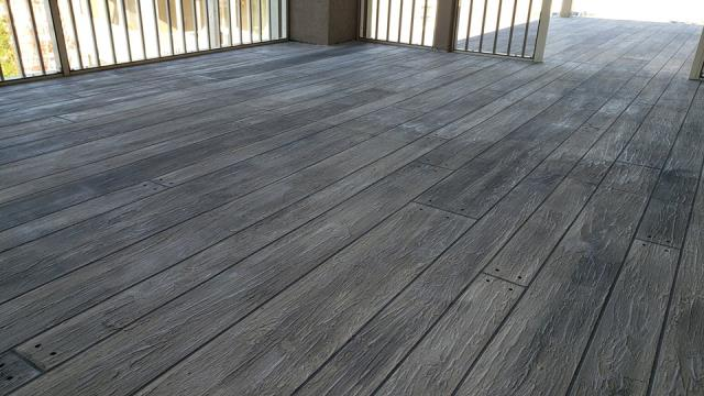 Warsaw, IN - Can you see the texture?!?! It looks just like real wood! I can't believe it's a decorative coating! I'm very surprised by the quality, and I'm very confident that it will stay looking just as nice for along time! Supremecrete does some fantastic work! Fair price, hard-working people, and they make beautiful coatings!