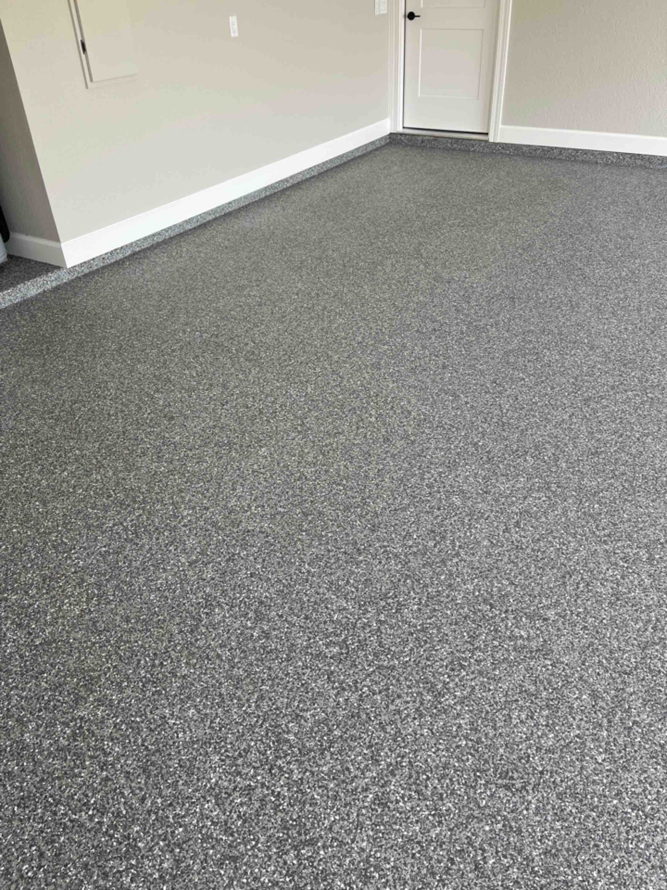 Auburn, IN - The crew just finished resurfacing the concrete with this epoxy flake floor. Near Auburn Indiana.