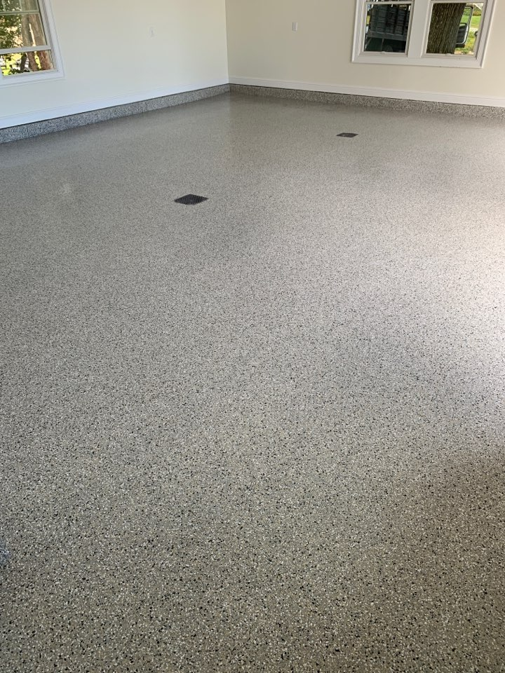 First layer of top coat is down on this epoxy flake floor! Color is cabin fever