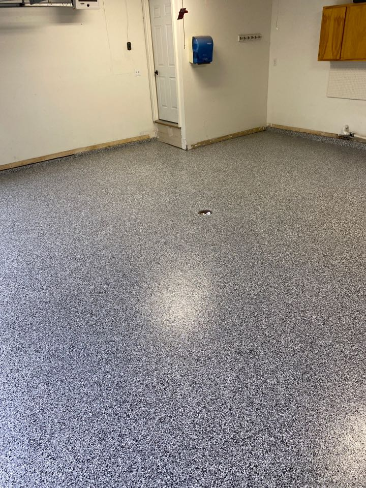 Fort Wayne, IN - Final topcoat going down on the absolutely BEAUTIFUL EPOXY FLAKE FLOOR!!! Showroom material!