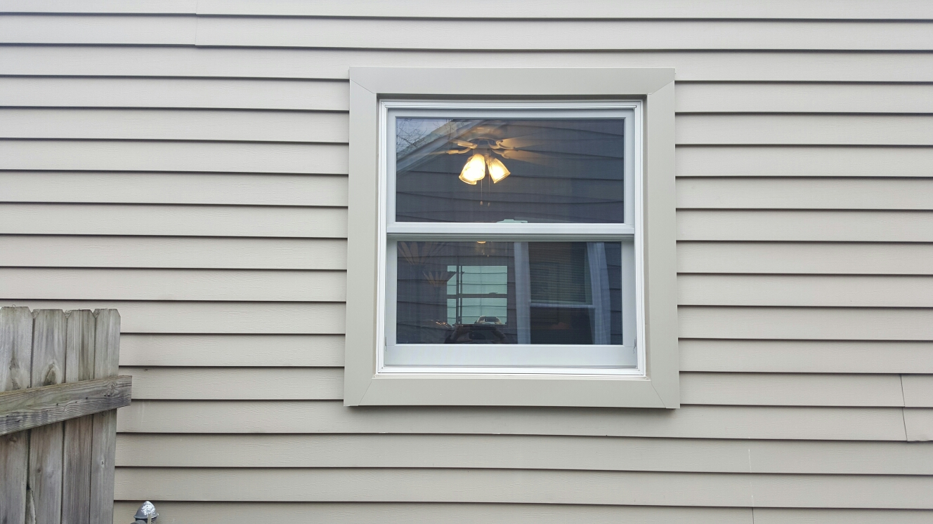 Livonia, MI - Installing energy-efficient Renewal by Andersen double hung windows!