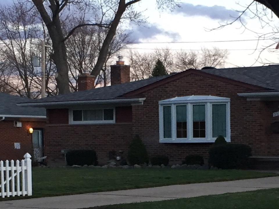 Farmington, MI - Renewal by Andersen window replacement. Removed a picture window in the living room and replaced it with a bow window and roof.