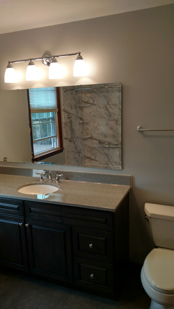 Gettysburg, PA - Another Rebath tub shower installed using Moen fixtures and a grab bar shelf. They also received a bertch vanity and an onyx top.