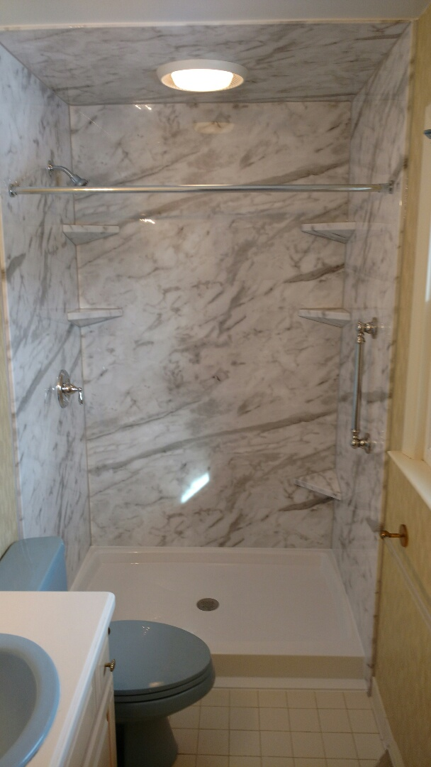 "York, PA - White Calcutta gloss surround with white Onyx shower base installed after removal of tile shower. Four matching shelves and one shaving step installed. Moen plumbing fixtures and 18"" grab bar also installed. Custom shower door to be installed at a later time."