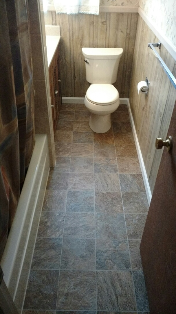 Lancaster, PA - Installed flooring and Kohler toilet to a ReBath tub and surround system that was previously done.