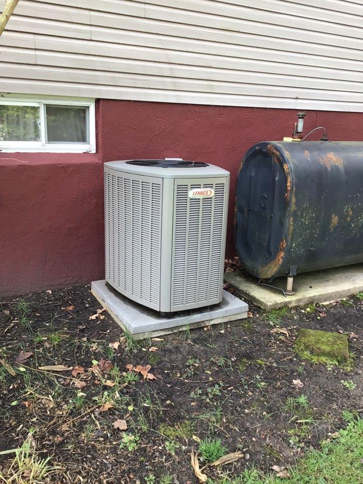 Port Deposit, MD - Preventive maintenance on a Lennox air conditioner