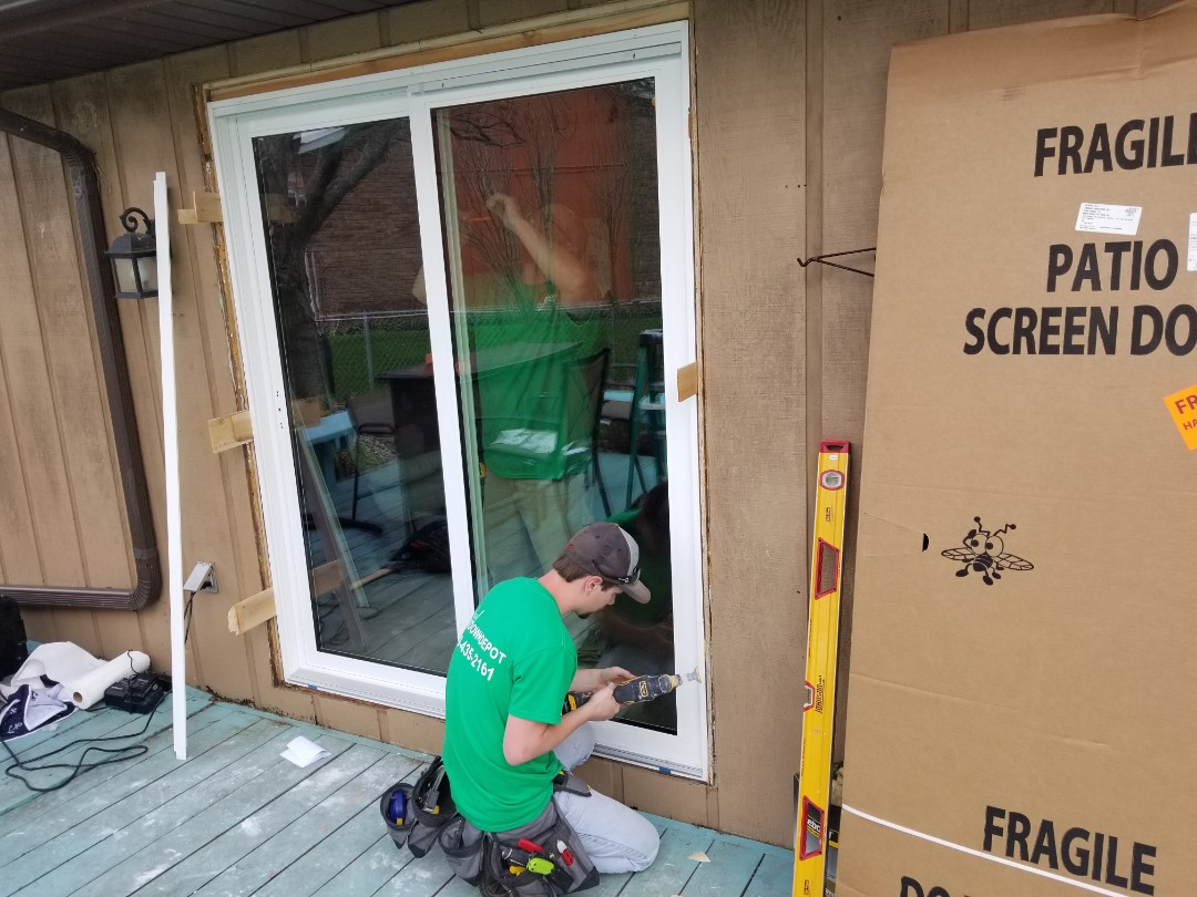 Findlay, OH - Gold series triple pane patio door installation under way in Findlay.