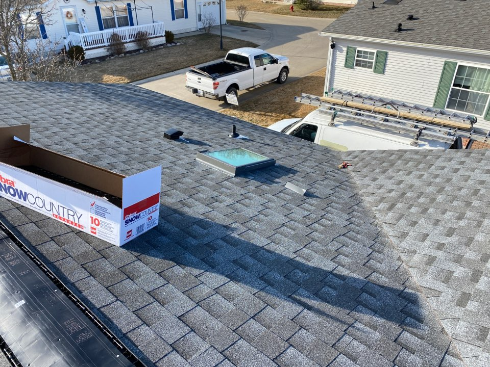 White Lake charter Township, MI - Completing a GAF Timberline Pewter Gray system warranty install.  Beautiful day March in Michigan!