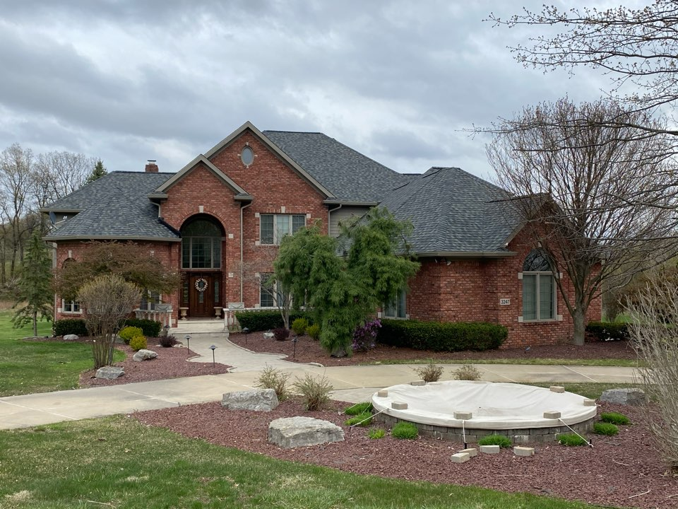 Milford Charter Township, MI - This beautiful home was completed on Sunday early afternoon. Generally don't work on a Sunday, but with a large one like this moved into the weekend.  The shingle we installed was Certainteed landmark pro colonial slate.