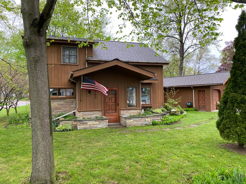 Highland Charter Township, MI - Completed this four-star Certainteed landmark pro weathered wood install last week.  Homeowners very happy we were able to keep their custom wood one by two beveled trim that they put there 30 years ago.  The guys really went above and beyond on this one.