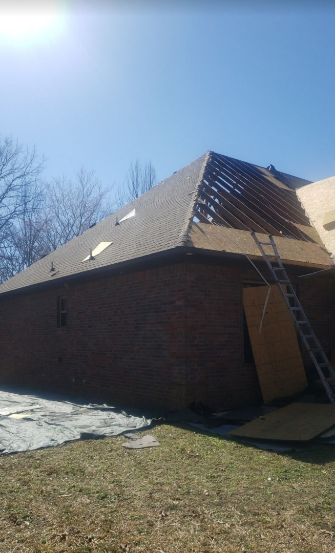 Vilonia, AR - Structural damage from Fire.  Full Roof and roof sheathing replacement