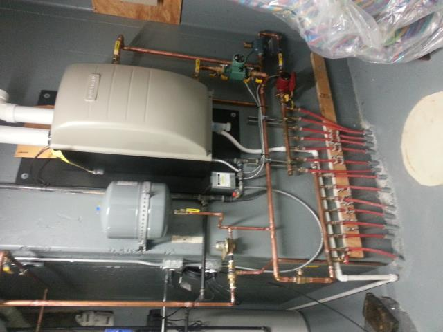Clarendon Hills, IL - This is how small you can make your hot water heater. Imagine all the square footage in your basement that is freed up! Now there is room for the Christmas tree...