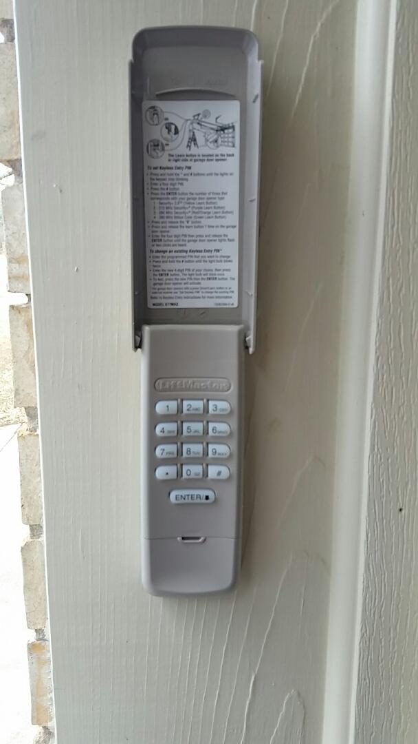 Pflugerville, TX - Programmed new garage door wireless keypad and opener.