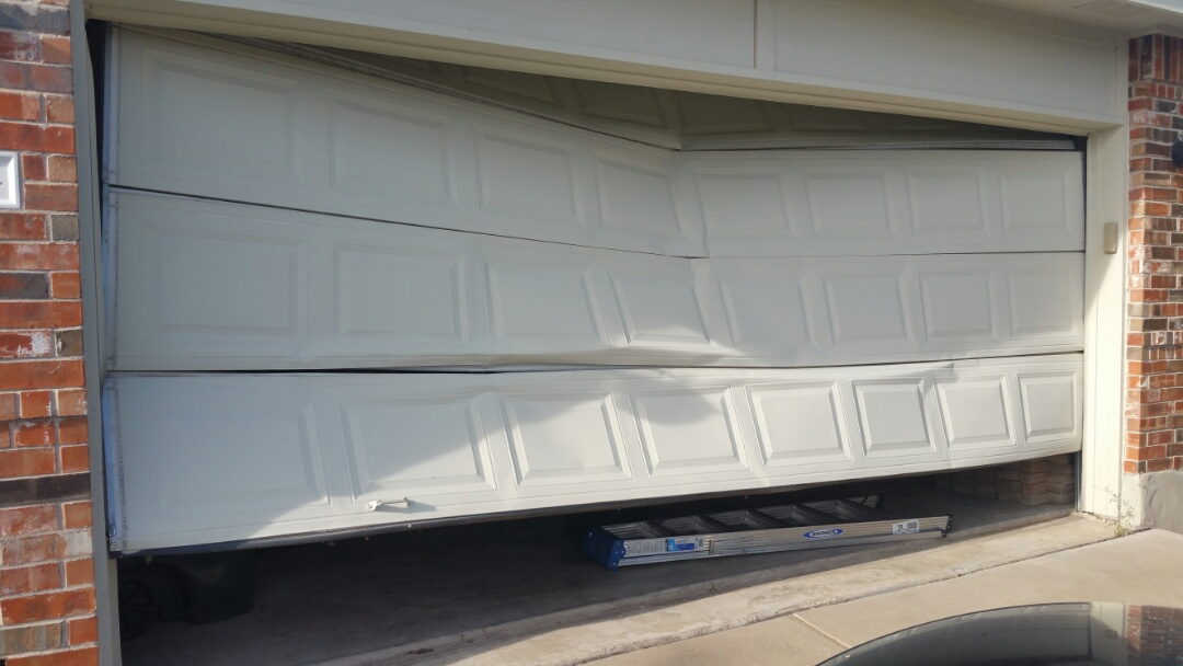 Pflugerville, TX - Garage door opened accidentally while still locked.  Temporarily secured until garage door can be replaced.