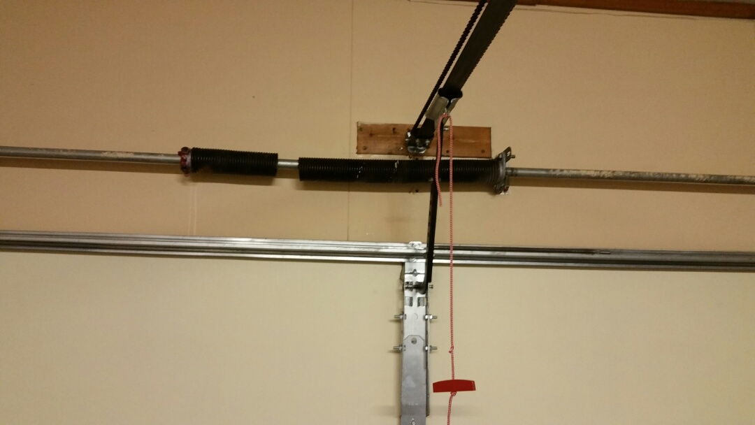 Austin, TX - Replaced a broken garage door torsion spring and lubricated.