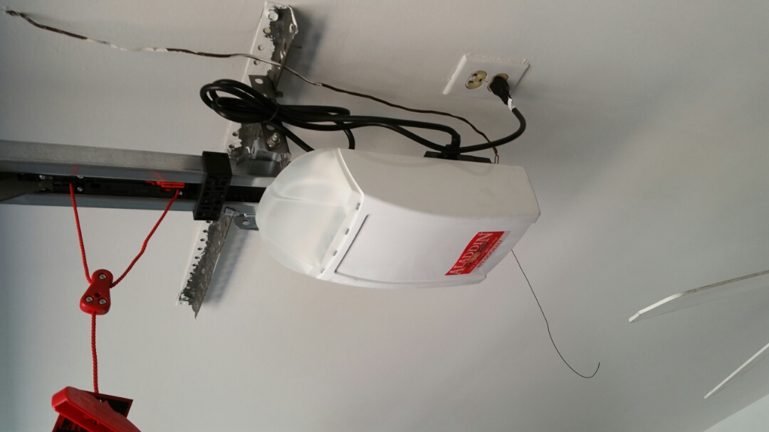 Austin, TX - Replaced an old genie screw drive garage door opener with a new marantec synergy 260 belt drive opener.
