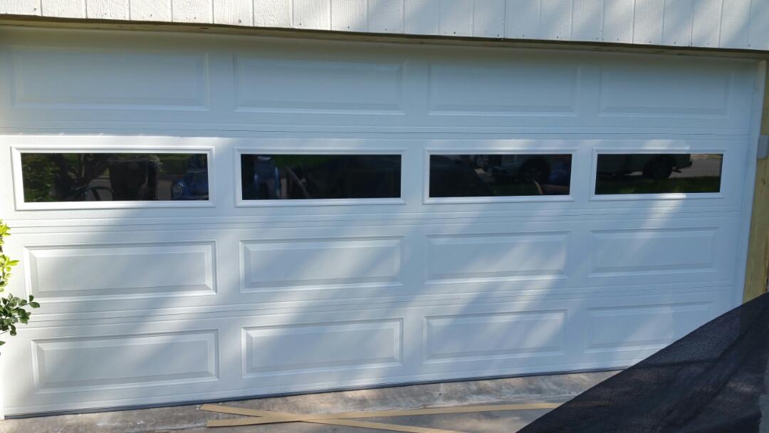 Round Rock, TX - Replaced an old wooden garage door with a new insulated 3 layer amarr garage door and liftmaster  wifi garage door opener.