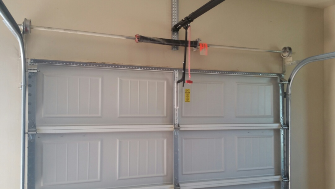 Austin, TX - Garage door cable was off the drum and the support had come come off the s Door. We added a piece of angle iron to supper the top section and also added a garage door opener support bracket.
