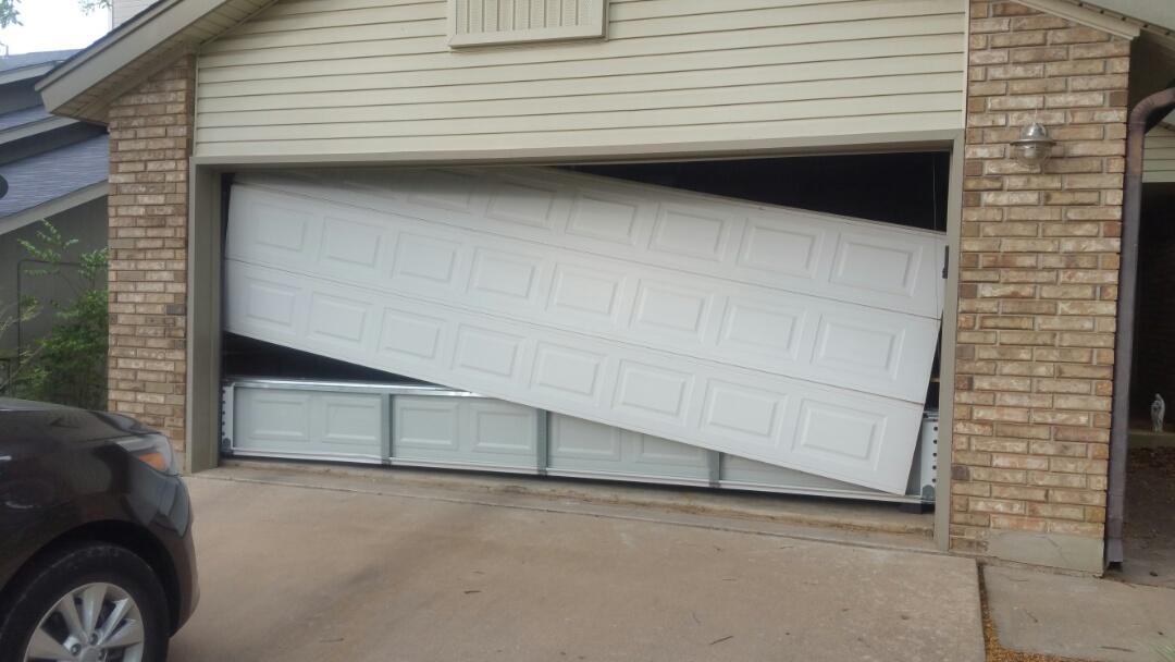Austin, TX - Rehung garage door.
