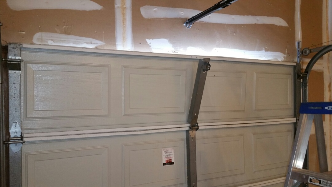 Pflugerville, TX - Garage door stile dislodged from garage door.  Added support to top of door and lubricated moving parts.