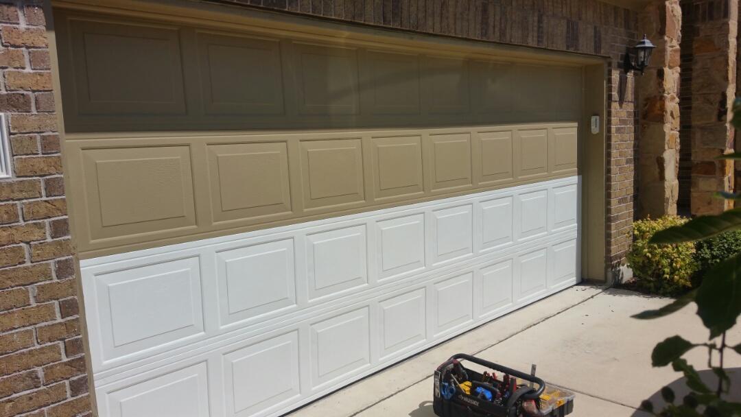 Cedar Park, TX - Damaged garage door sections.  Replaced two panels on garage door.