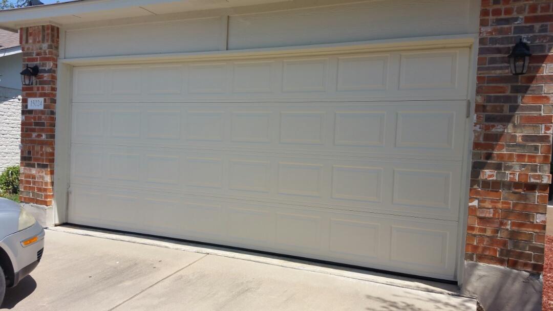 Pflugerville, TX - Damaged garage door sections.  Replaced entire garage door.